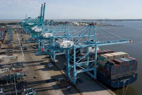 A container ship is unloaded May 10, 2019, at the Virginia International Gateway terminal in No ...