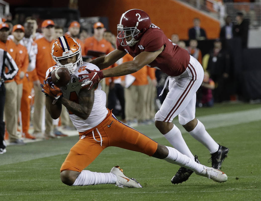 Clemson's Diondre Overton catches a pass in front of Alabama's Patrick Surtain II during the se ...
