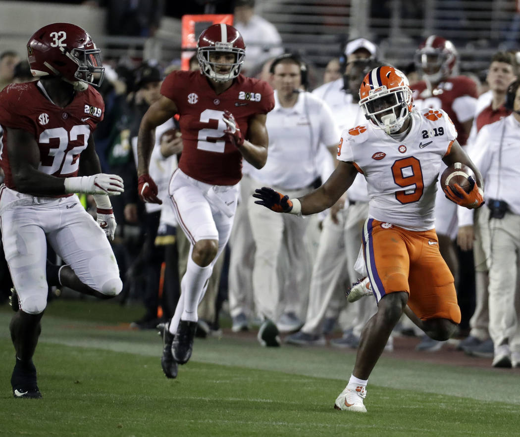 Clemson's Travis Etienne runs during the second half of the NCAA college football playoff champ ...