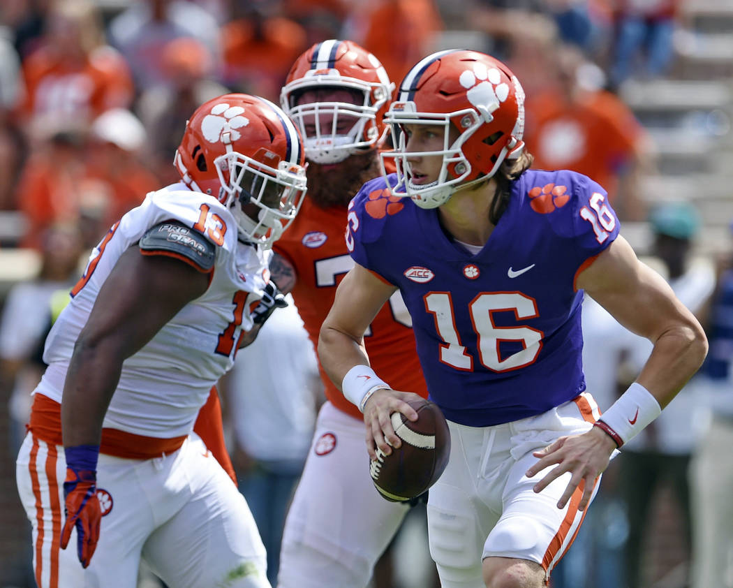 Clemson's Trevor Lawrence (16) scrambles out of the backfield during Clemson's annual Orange an ...