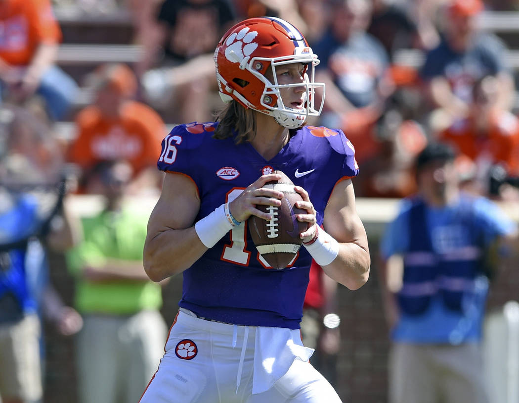 Clemson's Trevor Lawrence drops back to pass during Clemson's annual Orange and White NCAA coll ...