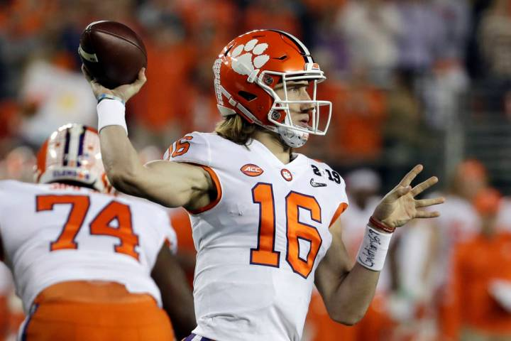 Clemson's Trevor Lawrence throws during the first half the NCAA college football playoff champi ...