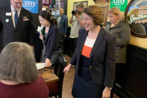 Sen. Amy Klobuchar, D-Minn., greets veterans at a roundtable discussion in Carson City, on her ...
