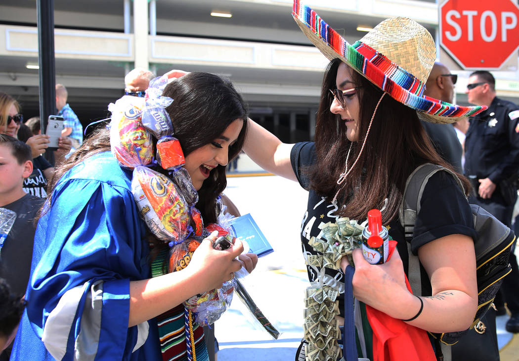 College of Southern Nevada High School student Itzel Sinoto, left, receives graduation leis fro ...