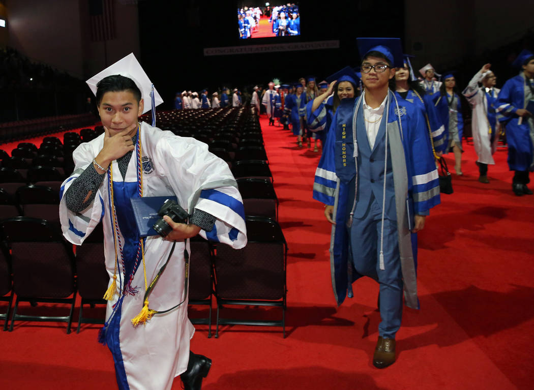 College of Southern Nevada High School student Carl Tiglao reacts after receiving her diploma d ...