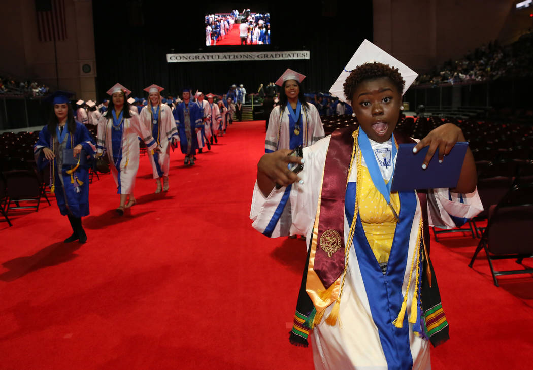 College of Southern Nevada High School student Keyana Webb reacts after receiving her diploma d ...