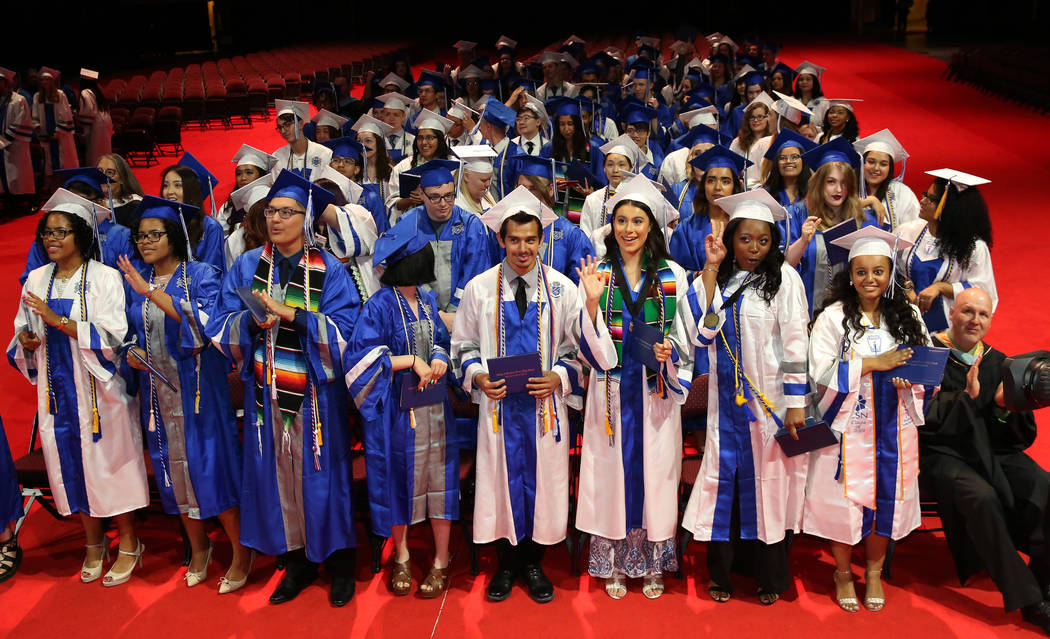 College of Southern Nevada High School students react at the end of their graduation ceremony a ...