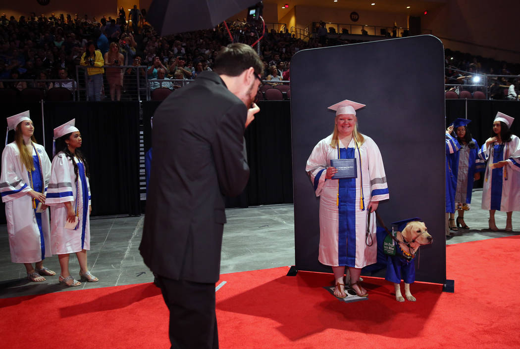 College of Southern Nevada High School student Sydney Hansen and her yellow lab, Boswell, pose ...