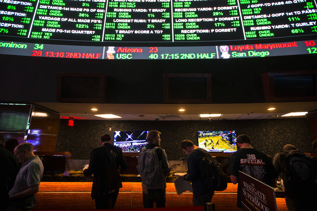 Bettors line up to place prop bets for the Super Bowl at the Westgate Superbook in Las Vegas on ...