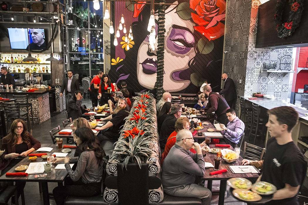 Guests are served in the dinning room at Bandito Latin Kitchen & Cantina on Saturday, Dec. ...
