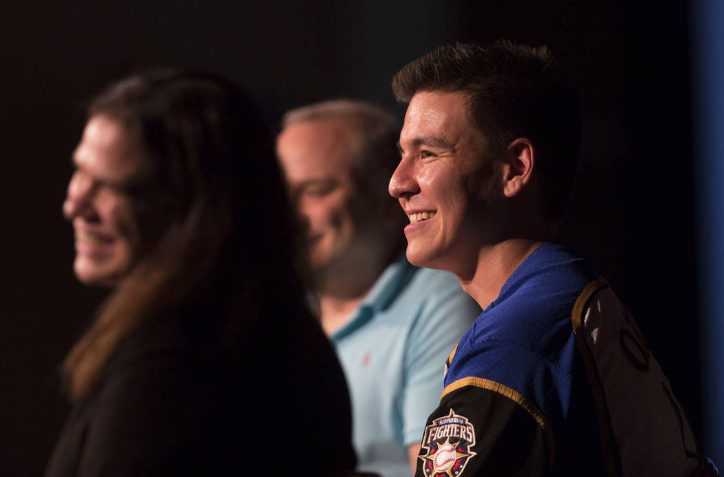 Jeopardy champion James Holzhaue, right, listens to a question from the audience during a semin ...