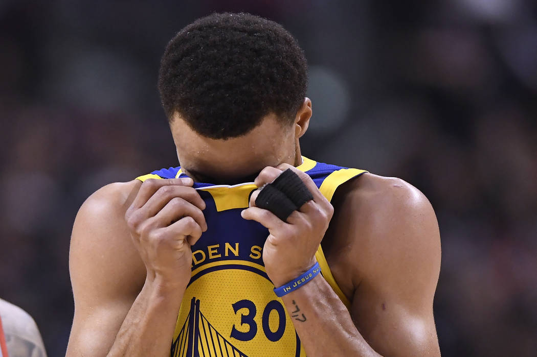 Golden State Warriors guard Stephen Curry (30) reacts during the second half of Game 1 of the t ...