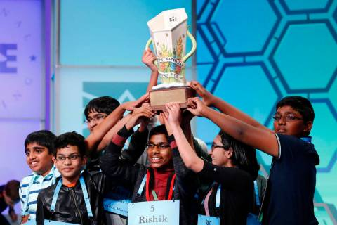 The eight co-champions celebrate after winning the Scripps National Spelling Bee, Friday, May 3 ...