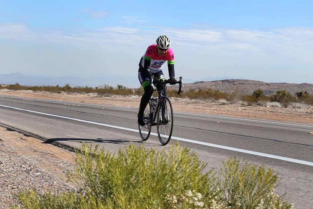 A cyclist rides his bike near Red Rock Canyon in Las Vegas. (Bizuayehu Tesfaye/Las Vegas Review ...