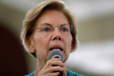 Democratic presidential candidate Sen. Elizabeth Warren speaks to local residents during a meet ...