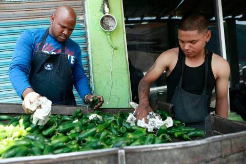 Workers prepare peppers for export from Mexico to the United States, in Ciudad Juarez, Mexico, ...