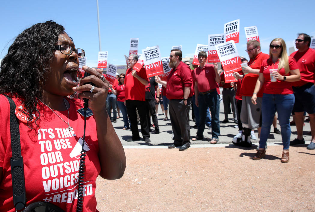 Linda Jones shouts slogans as about 50 members and supporters of the Clark County Education Ass ...