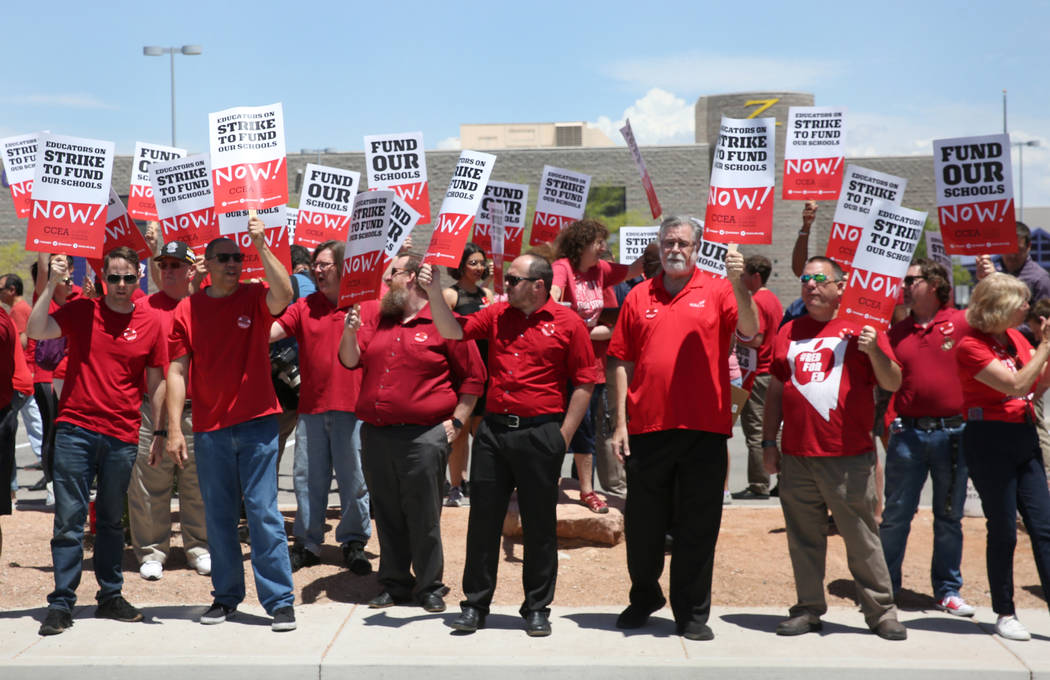 About 50 members and supporters of the Clark County Education Association protest in front of D ...