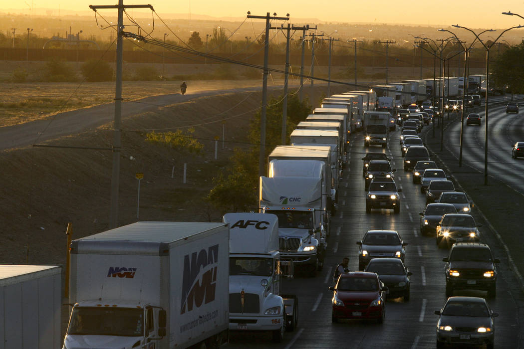 Trucks wait to cross the border April 9, 2019, with the U.S. in Ciudad Juarez, Mexico. In a su ...