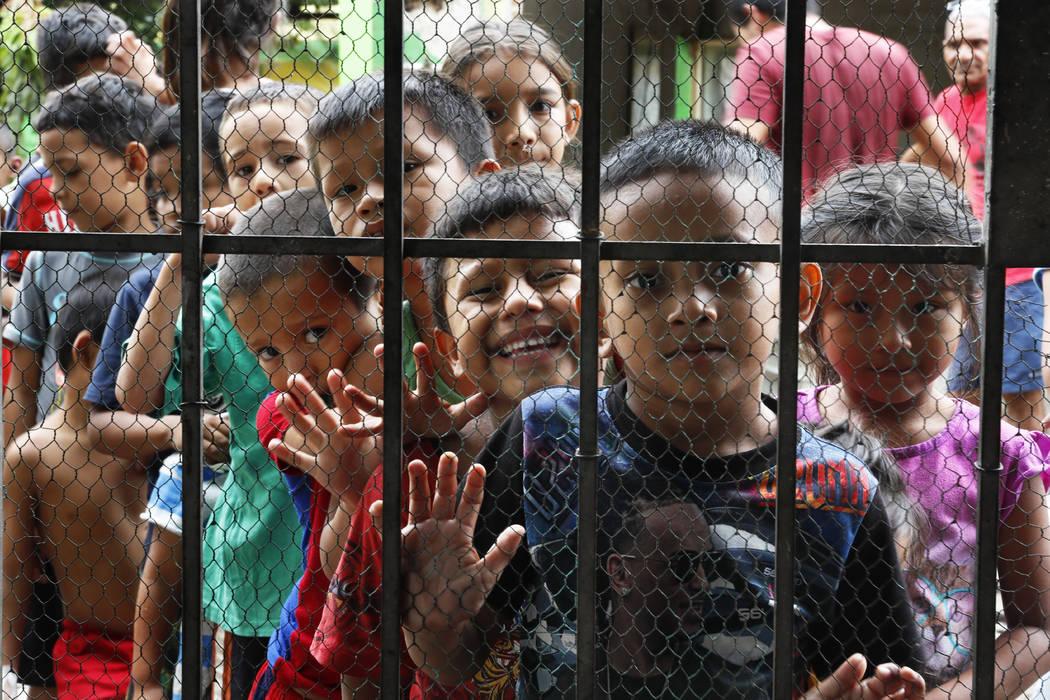 Migrant children line up for a meal at the door of the Jesus del Buen Pastor del Pobre y el Mig ...