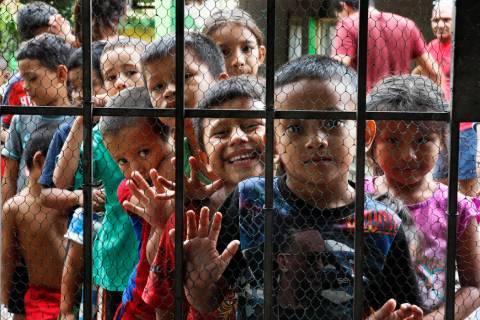 Migrant children line up for a meal at the door of the Jesus del Buen Pastor del Pobre y el Mig ...