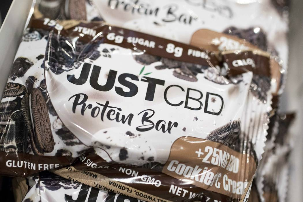 A cookies and cream flavored protein bar marketed by JustCBD is displayed at the Cannabis World ...