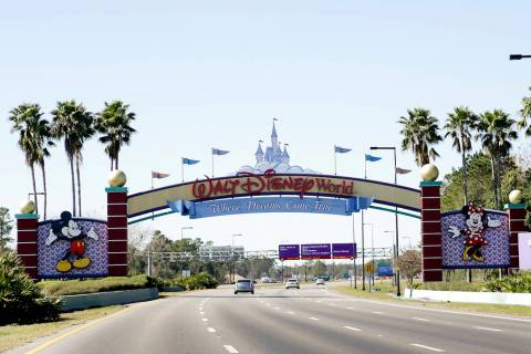 In this Tuesday, Jan. 31, 2017 photo, cars travel one of the roads leading to Walt Disney World ...