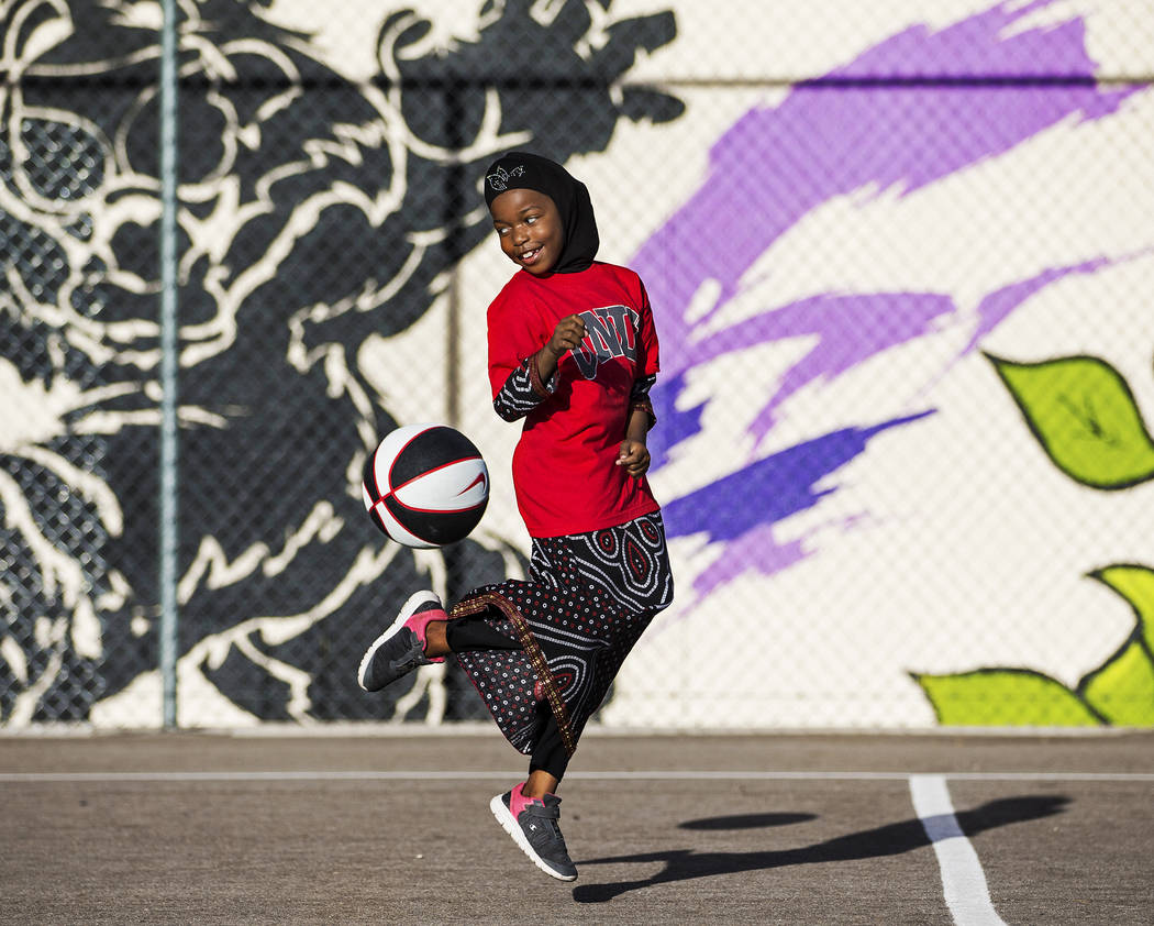 Fardosa Blial, 6, plays with a basketball during a youth clinic hosted by UNLV head basketball ...