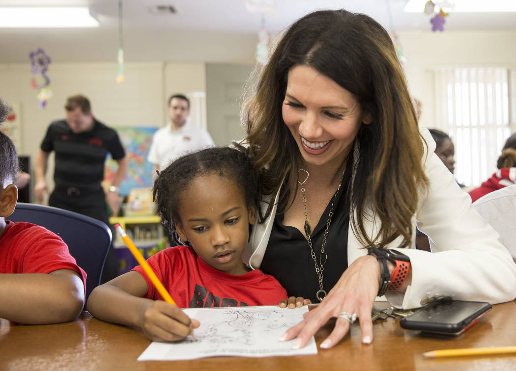 UNLV athletic director Desiree Reed-Francois, right, helps Jayceon Jackson, 6, with her homewor ...