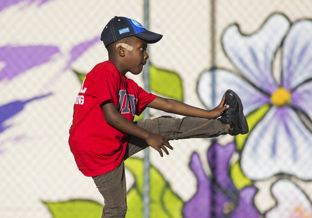 Devori Brown, 6, stretches during a youth clinic hosted by UNLV head basketball coach T.J. Otze ...
