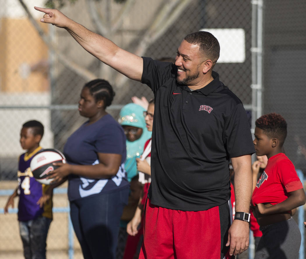UNLV assistant coach DeShawn Henry, middle, cheers on kids with the Nevada Youth Network during ...