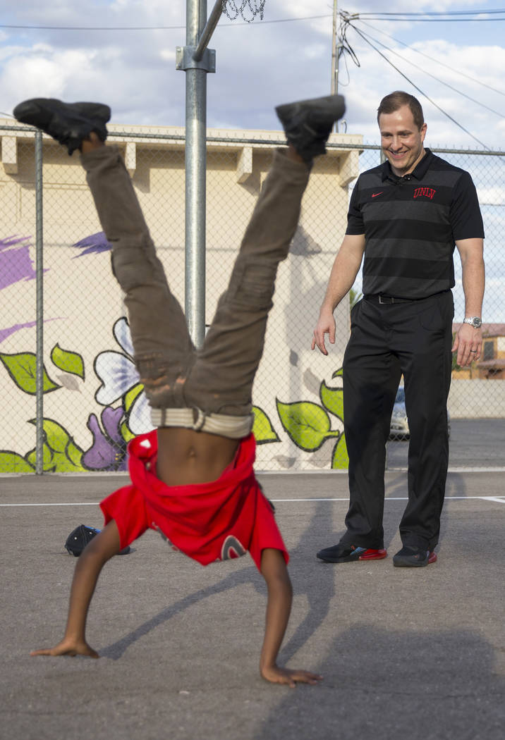 Devori Brown, left, 6, shows UNLV head basketball coach T.J. Otzelberger his moves during a you ...