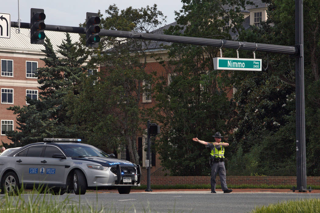 A police officer directs traffic away from the intersection of Princess Anne Road and Nimmo Par ...