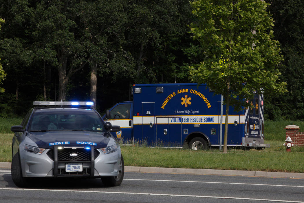An ambulance turns on Nimmo Parkway following a shooting at the Virginia Beach Municipal Center ...