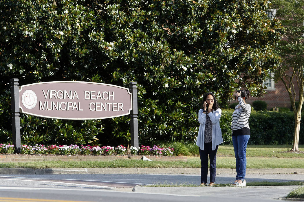 Women wait by an entrance to the Virginia Beach Municipal Center on Princess Anne Road followin ...