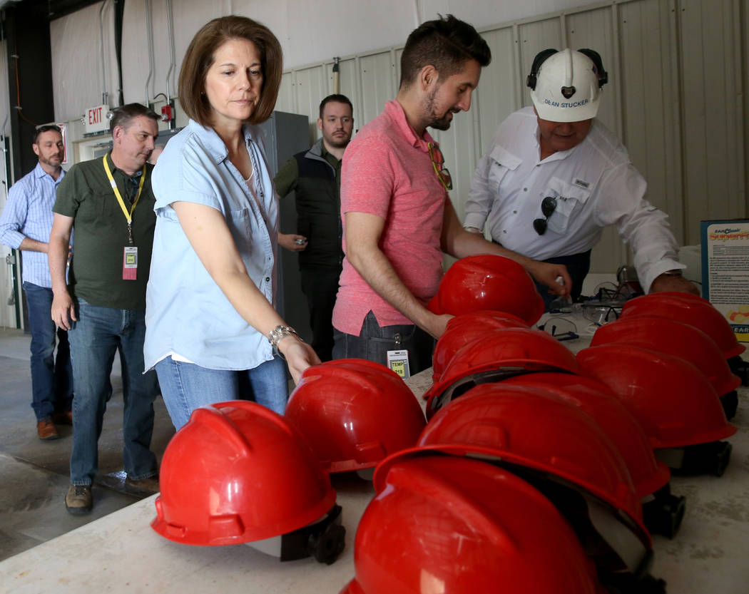 U.S. Sen. Catherine Cortez Masto, D-Nev., takes a hard hat before a tour of Yucca Mountain 90 m ...