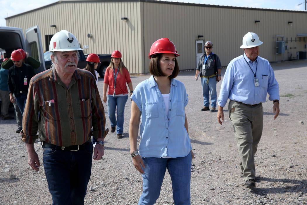 U.S. Sen. Catherine Cortez Masto, D-Nev., walks with Steve Frishman, a technical consultant to ...