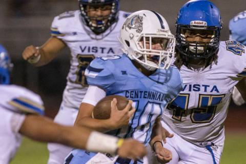 Centennial sophomore quarterback Colton Tenney (10) runs for big yardage against Sierra Vista i ...