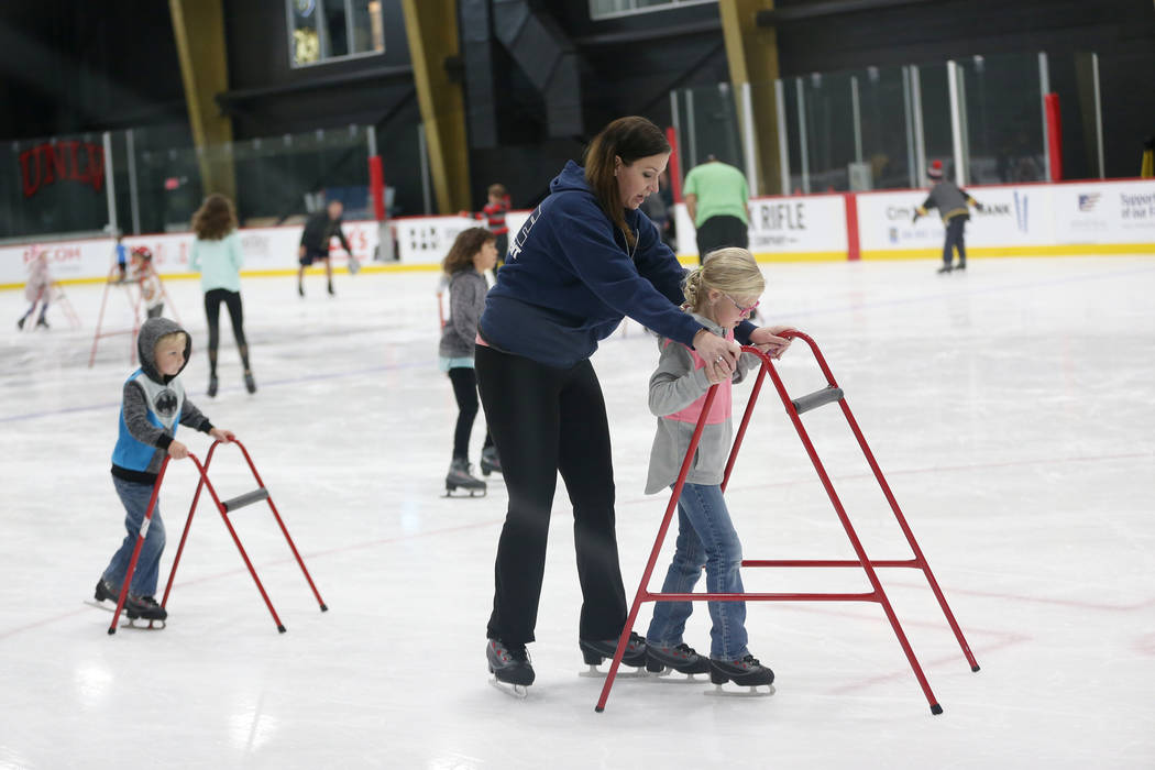 Jody Domineck of Las Vegas with her daughter Rura, 7, and Graham, 5, left, during the Jake Kiel ...