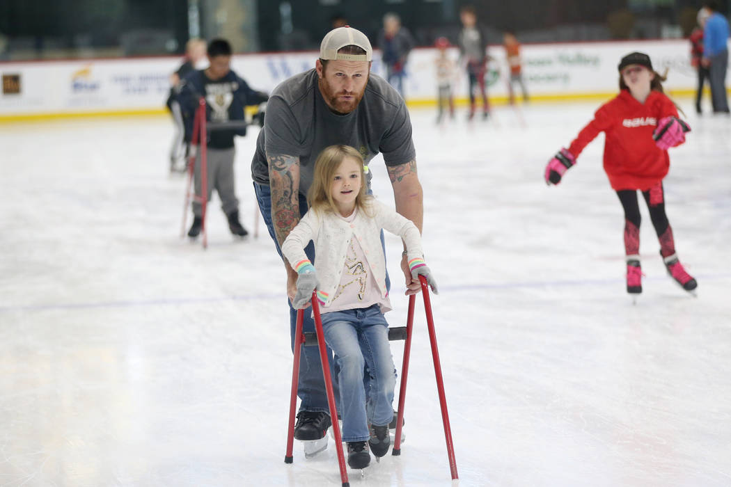 Tim Sussman of Las Vegas with his daughter Addie, 5, during the Jake Kielb's Hockey Foundation ...