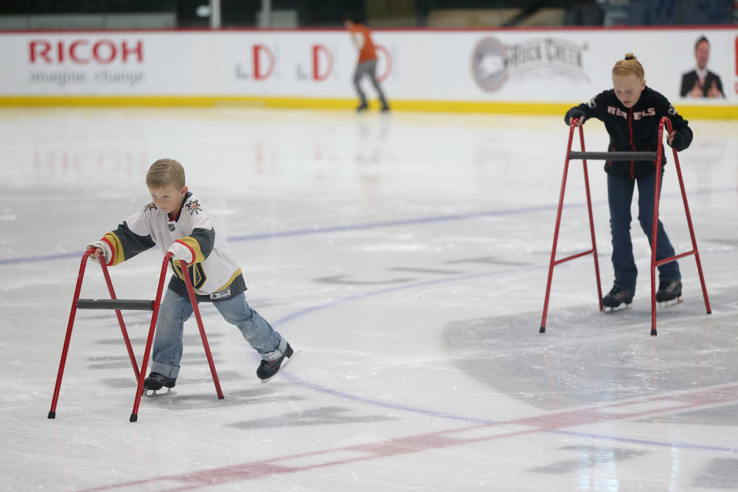 Weston Gregory, 6, left, and his sister Daphne, 10, during the Jake Kielb's Hockey Foundation o ...