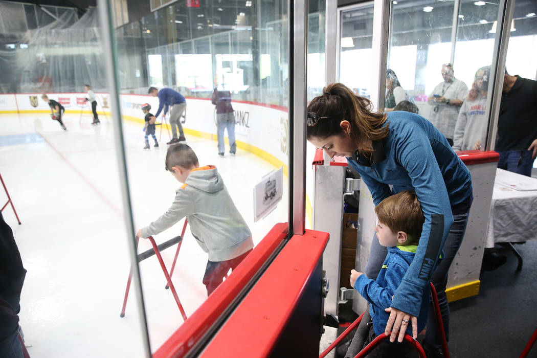Erin Sturgeon of Las Vegas with her son Bryce, right, and Carsen, 5, left, during the Jake Kiel ...