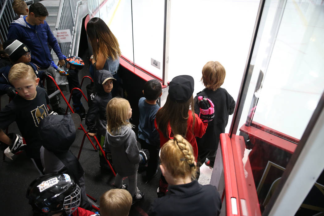 Children get ready to take the ice for the Jake Kielb's Hockey Foundation open skate session at ...