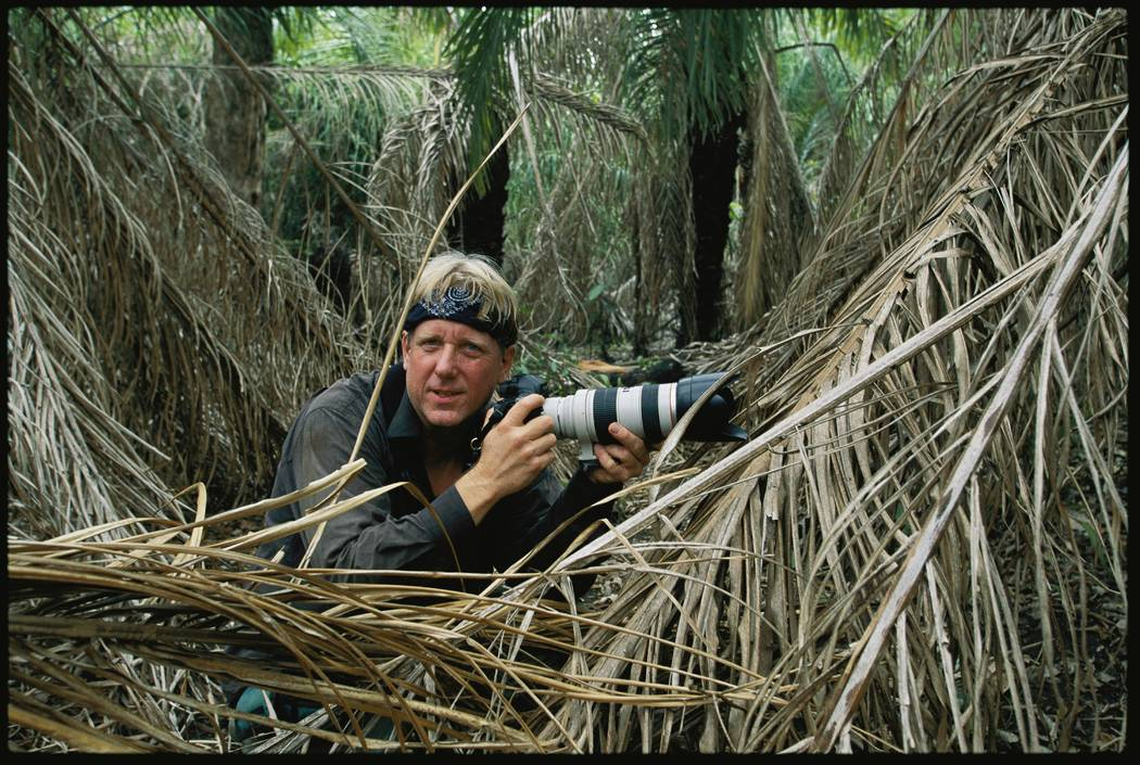 Photographer Steve Winter in the wild waits to photograph a jaguar (Steve Winter)