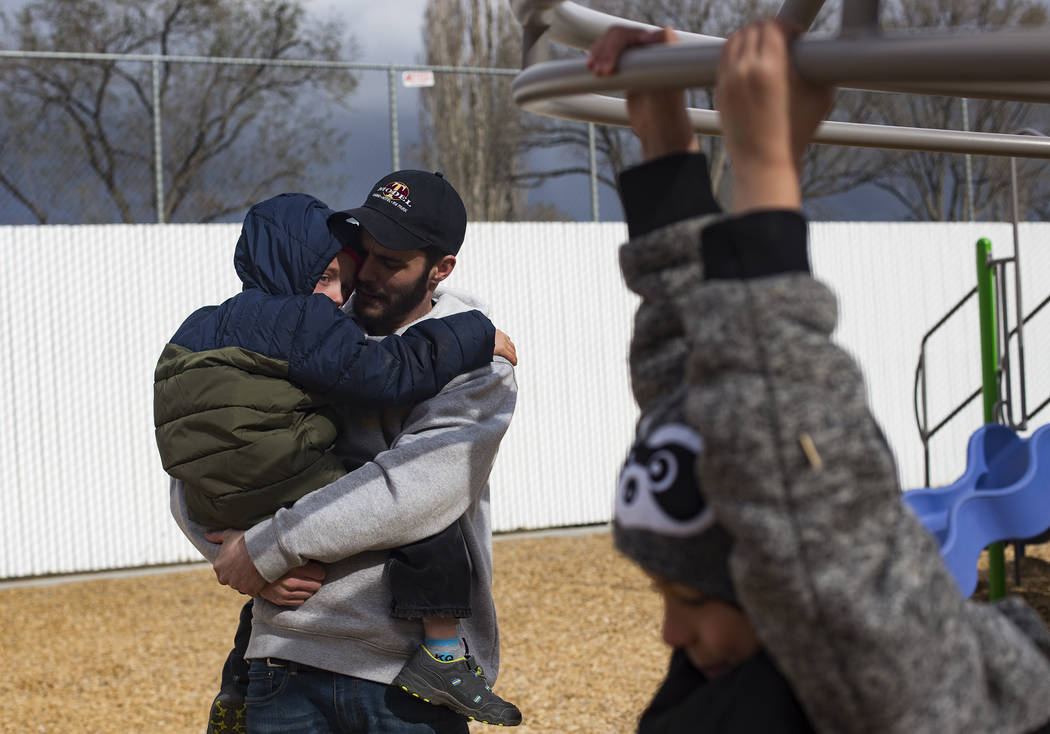 Daniel Shaw holds Bentley Brown, 4, at a park in Winnemucca, Nev., Tuesday, April 9, 2019. Shaw ...