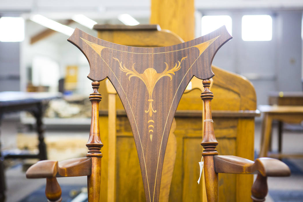 Woodwork design on a chair, from Walking Box Ranch in Searchlight, is seen at UNLV's Paradise c ...