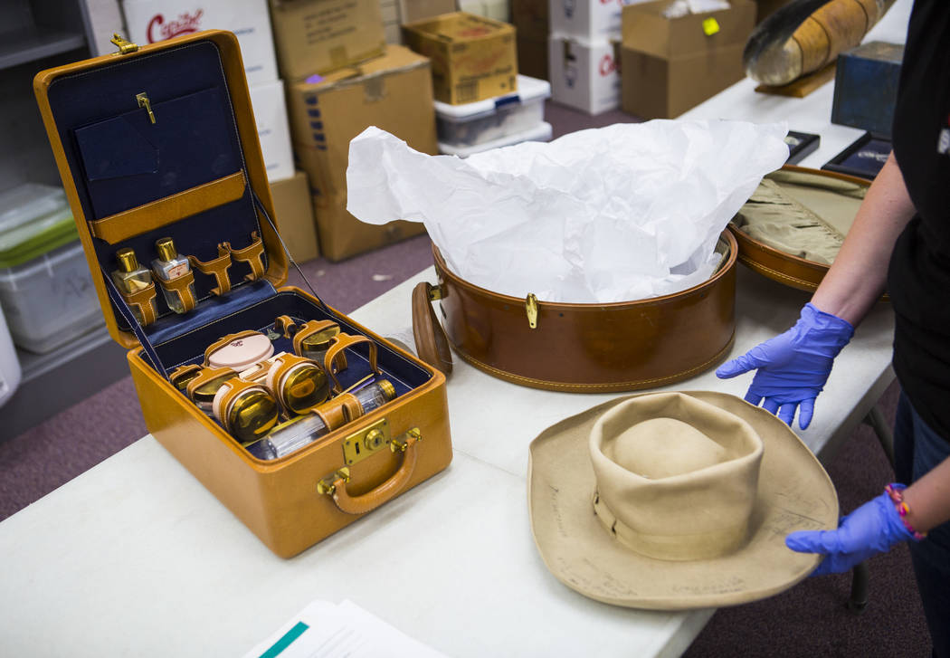 A variety of items, including Clara Bow's makeup kit, left, as well as a signed cowboy hat, fro ...