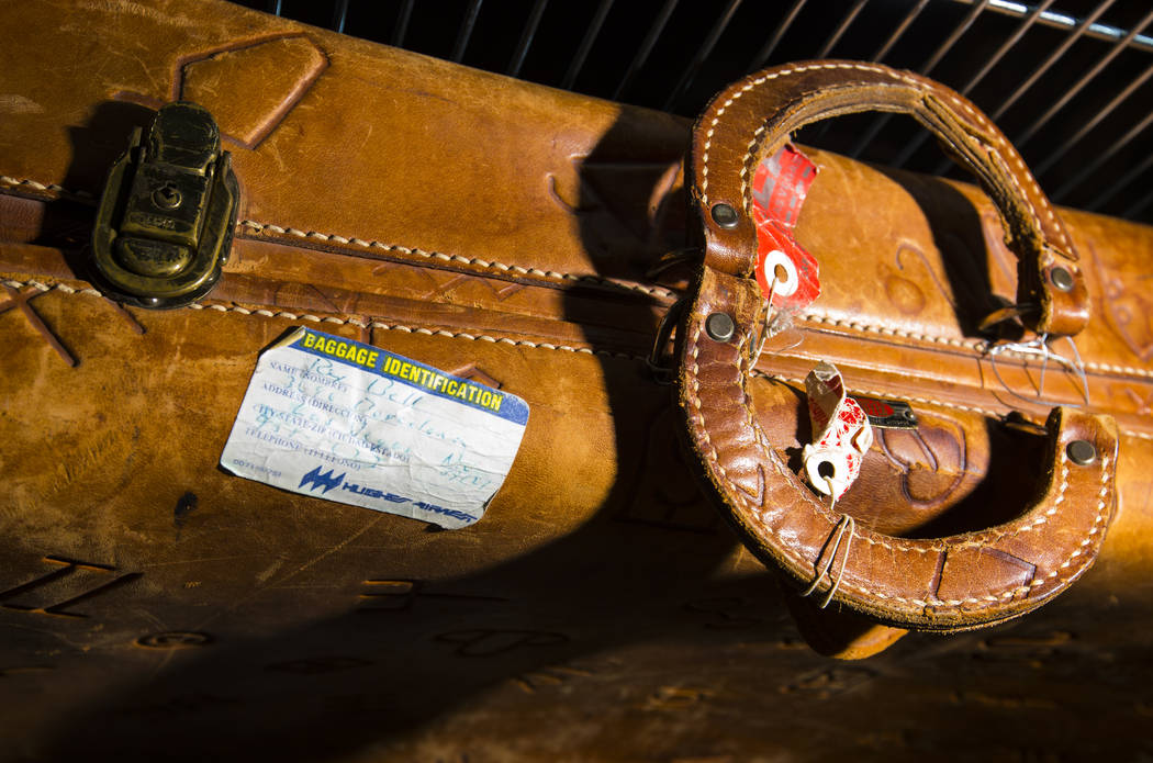 A leather suitcase with a handwritten ID tag from Rex Bell is seen as items from Walking Box Ra ...