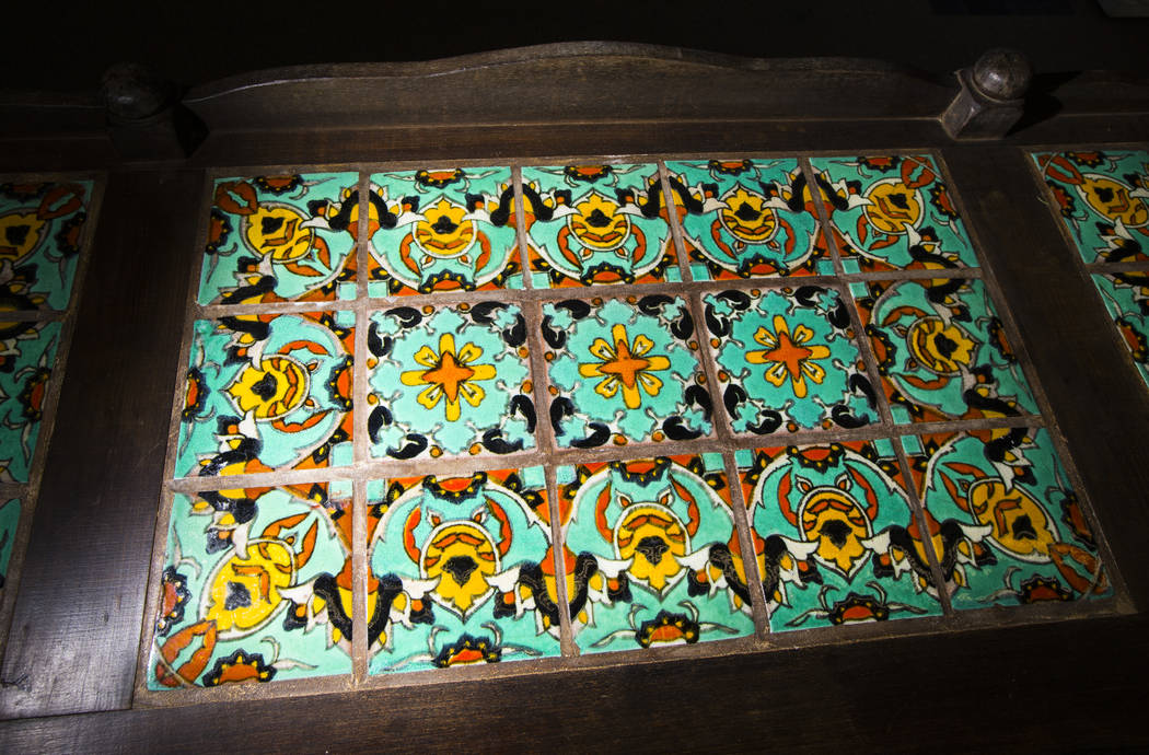 Tile detailing on a mission style credenza, from Walking Box Ranch in Searchlight, is seen at U ...