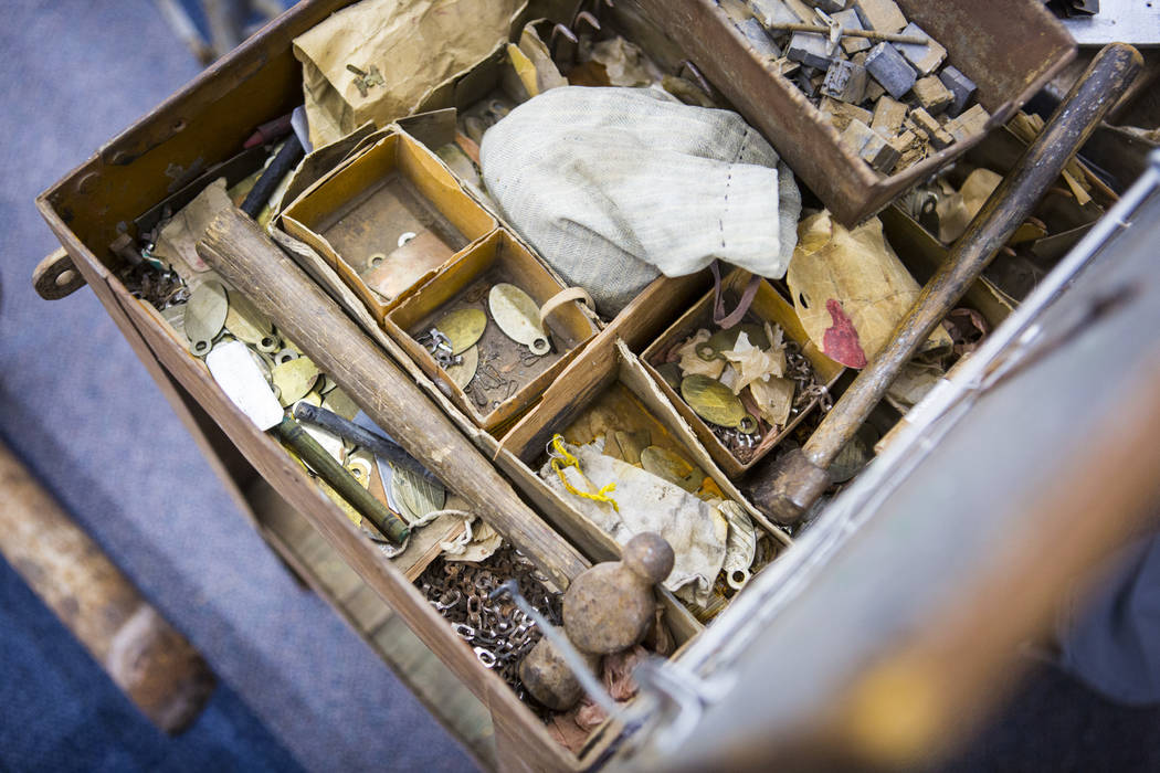 A variety of items are seen in a box from Walking Box Ranch, in Searchlight, at UNLV's Paradise ...